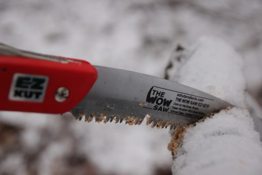 Red Wow Saw cutting in winter